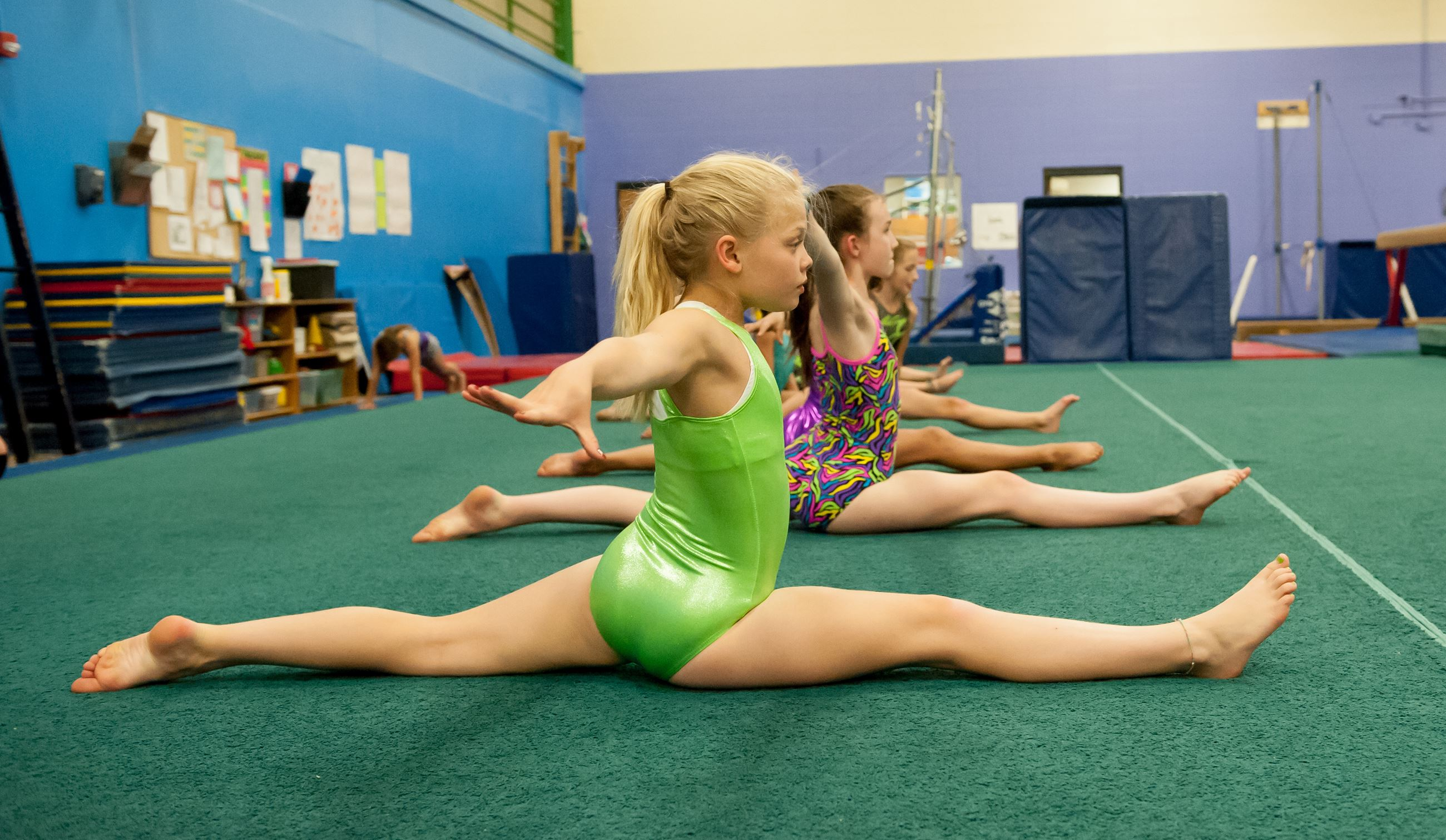 Row of Young Girls Doing the Splits