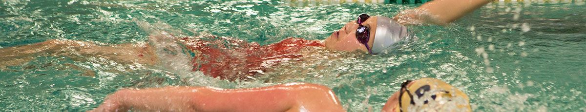 Swimmer doing backstroke in lap pool