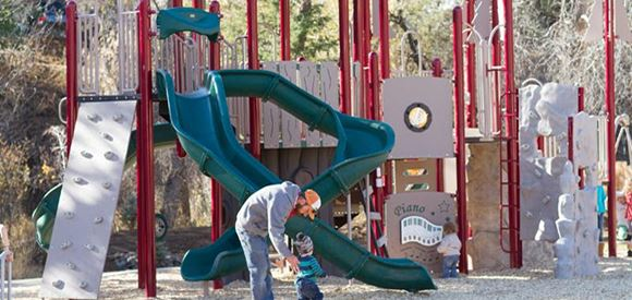 Father with Children at Kittredge Park Playground