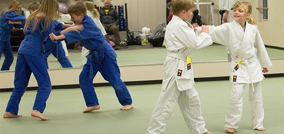 Two Pairs of Kids Practicing Martial Arts