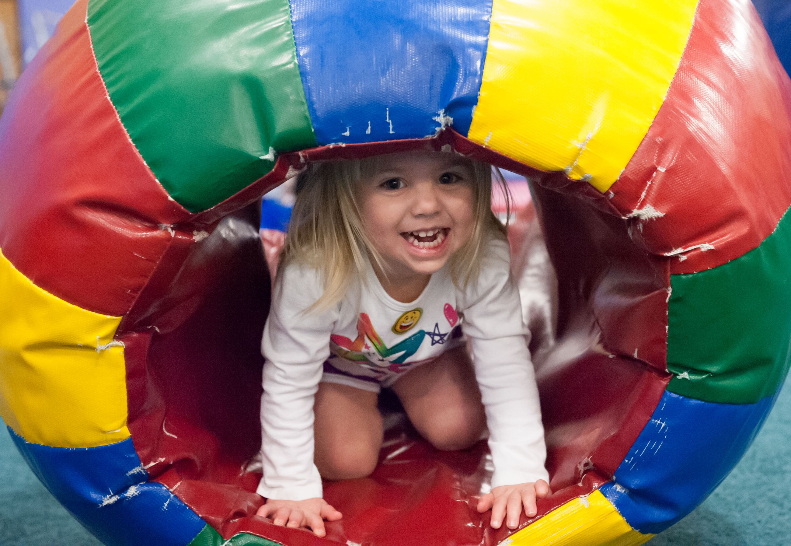 Little Girl in a Colorful Tunnel Toy