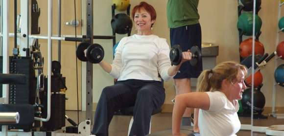 People Lifting Weights in a Gym